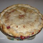 Dried Cherries and Apple Pie - Tart cherries, sweet apples, sugar, flour, cinnamon and butter go into this sweet pie. It bakes up golden brown on the inside and a wonderful cherry pink on the inside.