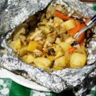 Campfire Foil Packs - Chicken, potatoes, mushrooms, and peppers are wrapped in aluminum foil for one-dish meals cooked in a campfire!  These are easy to make for camping, my husband loves them!  We prepare them at home and then leave them in the cooler until we are ready to cook.  You can use any combination of meat and vegetables that you like.