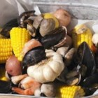 Clam Bake - This is the most fun you can have with your seafood.  It started with the idea of a fun get-together clam bake then took off with a life of its own.  This recipe is a general guide.  Have fun, mix and match your favorite seafood. I would ask your fish monger what is fresh, and  then decide what seafood to add. I've even added a whole octopus before. Serve with a nice white wine, turn on some music and have fun. Great outdoor meal.
