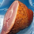 Baked Ham - In this simple and slightly unorthodox preparation, a ham is baked in an oven bag with a half of a can of cola.