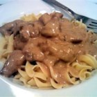 Beef Tips and Noodles - Cubed sirloin tips baked with mushrooms in cream of mushroom soup mixed with beef and onion soup mix. Served over egg noodles. Great with dinner rolls or garlic toast.