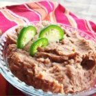 Refried Beans Without the Refry - Flavorful refried beans seasoned with garlic, jalapeno, and cumin are simple to make when cooked in a slow cooker.