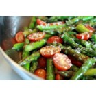 Asparagus Side Dish - This side dish involves steaming asparagus and grape tomatoes and topping with olive oil and Parmesan cheese.