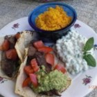 Carne Asada Marinade - This simple garlic and olive oil rub is a great way to marinate beef steaks before grilling.