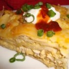 Chicken Chipulos -  A creamy chicken-chili casserole layered with tortillas and cheddar.