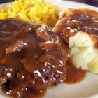 Salisbury Steak - Ground beef is mixed with condensed onion soup, bread crumbs, and egg, then formed into patties which are browned and simmered in a sauce made with more soup and seasonings.