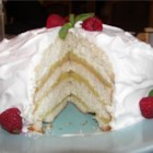 Lemon Layer Cake - An old fashioned lemon cake recipe.  It is usually made up of 3 to 6 white cake layers with a cooked lemon filling between the layers and iced in Seven Minute Frosting.