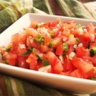 Pico De Gallo - Pico de gallo, made with fresh tomato, onion, and jalapeno, is perfect for serving with your favorite Mexican dishes.