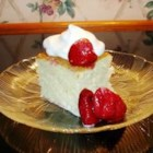 Tres Leches Cake - The three milks in this egg rich Mexican cake are used to macerate and frost this high, single-layer cake decorated with Maraschino cherries.