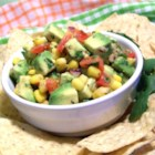 Corn and Avocado Salsa - Avocados and fresh corn from the cob cohabitate with red pepper flakes, red wine, spices, herbs, and vinegar in this sassy salsa. Try it as a side dish with grilled chicken, or eat it plain with tortilla chips.