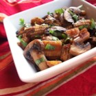 Stir-Fried Mushrooms with Baby Corn - Seasonal fresh mushrooms and baby corn are stir-fried with fish sauce, light soy sauce, and oyster sauce for a quick Thai side dish with Chinese influences.