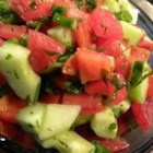 Israeli Salad - Chopped tomatoes, cucumbers, onions, and parsley combine with a drizzled dressing of lemon juice, olive oil, garlic, and mint leaves.