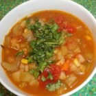 Vegan Mexican Stew - This vegan stew is absolutely excellent. A spicy hearty dish that is sure to make everyone smile. Top with chopped cilantro, if desired.