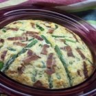 Springtime Quiche - This easy quiche makes its own crust as it bakes, thanks to the biscuit baking mix. It's filled with crumbled bacon, asparagus, and Swiss cheese. Use egg substitute or fresh eggs--whichever you prefer.