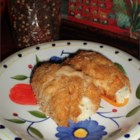 Garlic Cheese Chicken Rollups -  A Parmesan-butter crust  encases chicken rolled around a dollop of garlic cheese.