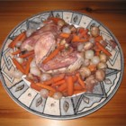 Coq au Vin - Chicken, herbs and vegetables steeped in a Burgundy wine sauce--a classic French preparation.