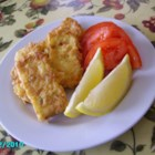 Greek Saganaki - Serve this traditional Greek appetizer of pan fried feta cheese with slices of ripe, red tomatoes fresh from the garden.