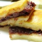 Chinese Sticky Rice Cake - Dollops of red bean paste are hidden in this chewy, sticky rice cake.