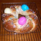 Easter Bird's Nest Bread - This decorative, tasty bread looks like a bird's nest when finished. Use raw eggs that you've colored to put in the center. They cook right along with the bread! This is a favorite in my family, and we have it for breakfast every Easter Sunday with the eggs we've colored. This Easter bread is especially tasty because it has a faint hint of lemon in it. My favorite way to eat it is warmed up, with butter spread on top.