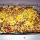 Taco Bake II - The whole family will enjoy this taco casserole consisting of ground beef, tomatoes and sour cream, then seasoned with taco seasoning. It's all layered with corn tortilla chips and Colby and Monterey Jack cheeses, then baked until the cheeses are melted and bubbly.