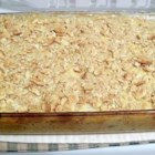 Cheesy Chicken and Rice Casserole - You can do all the prep work the night before, combining the chopped chicken with rice, cheddar and cream of chicken soup right in the baking pan.  Top with soft bread cubes just before you pop it in the oven.