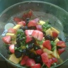 Mango Madness Salad - Toss this fruit salad together in minutes. Made with mangoes and berries tossed with cilantro and lime juice, the flavors in this salad go together wonderfully, and create a beautiful looking and delicious fruit salad that is truly refreshing.