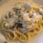 Slow Cooker Italian Chicken Alfredo - Slow cooked chicken is cheesy, creamy, and fantastic when served over hot spaghetti.