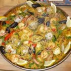 Maria's Paella - This delicious seafood paella has been made by my family in Catalonia, Spain for many generations. Chicken, shrimp, calamari, clams, and scallops are cooked to perfection in saffron-flavored rice.