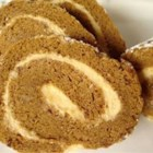 Pumpkin Roll Supreme - A pumpkin cake roll with sweetened cream cheese filling.