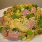 Pineapple Fried Rice II - The delicious sweet and savory combination of pineapple, ham, peas, green onion, and eggs quickly wok-fried with rice is a sure-fire family favorite. Start with leftover cold rice for a super quick weeknight meal.