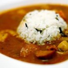 Merwin's Shrimp Gumbo - This is a recipe for a classic, dark brown, shrimp gumbo in true Louisiana Cajun country fashion.  Serve over rice.  Browning the chicken pieces in the oil used for the roux adds flavor to the dish.  I use the cooked chicken for chicken salad.  File is added off the heat to thicken the gumbo. If added while the gumbo is still cooking, it may become stringy and unpleasant.  File is ground sassafras leaves.  It is available in many supermarkets.