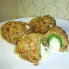 Armadillo Eggs - Cheese-stuffed jalapeno peppers are stuffed inside cheesy, spicy biscuits!