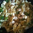 Best Ever Pasta Salad - Rotelli pasta and chicken breast chunks are tossed in a tangy, herb-rich vinaigrette studded with capers and dotted with bits of creamy Havarti cheese.