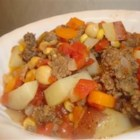 Hopi Corn Stew - Ground beef is cooked in a spicy stew with hominy, potatoes and carrots. You could use venison or buffalo in place of beef.