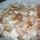 Waldorf Salad II - Walnuts, grapes, apples, celery and raisins are folded into a mayonnaise and whipped cream dressing in this variation on this classic salad which serves four.
