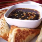 Easy Asian Dipping Sauce - This dipping sauce features minced garlic and ginger in soy sauce and rice wine vinegar.