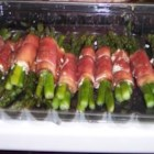 Asparagus Wrapped in Crisp Prosciutto - Extremely easy and elegant appetizer. Asparagus spears are wrapped in a sheath of prosciutto, then baked until crispy. A great dish to make ahead, and bake just before serving.
