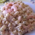 Mom's Shrimp Macaroni Salad - My mom's unusual salad has been popular with friends and family for many years. This salad calls for a lot of ingredients but is worth the effort. If possible, use pickle juice instead of the vinegar.