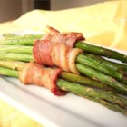 Bacon-Wrapped Asparagus - 'My husband and I grill dinner almost every night, and I love grilling asparagus for a side dish,' relates Patricia Kitts of Dickinson, Texas. 'I serve these bacon-wrapped spears with grilled meat and sliced fresh tomatoes for a wonderful meal.'