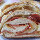 Easy Pepperoni Bread - Frozen bread dough makes this tasty recipe a breeze to prepare! Pepperoni, mozzarella cheese and Italian seasonings are rolled together, baked to delicious perfection, then cut into bite-sized delights. Your guests will beg for the recipe!
