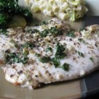 Lemon Garlic Tilapia - Tilapia fillets are bathed in lemon juice and melted butter, seasoned with garlic and parsley, and baked to flaky perfection.