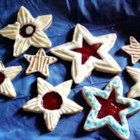 Raspberry Star Cookies - A delicious cookie filled with raspberry jam and topped with an almond flavored glaze.