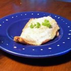 Salmon with Dijon Cream Sauce - A creamy wine sauce is spread over salmon baked with sour cream.