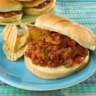 Emily's Famous Sloppy Joes - Ground beef is sauteed with bell pepper and onions. Brown sugar, cumin, and oregano add interesting flavor notes to this old favorite.