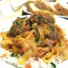 Grandma Elaine's Unstuffed Sweet and Sour Cabbage - Enjoy the flavors and ingredients of traditional cabbage rolls adapted in this heirloom recipe into a savory stew featuring tomatoes, cabbage, onions, and meatballs.