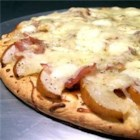 Pear and Prosciutto Pizza - Using a pre-made pizza crust dough, this pizza is topped with oven-roasted garlic and pears, mozzarella cheese, Swiss cheese, and prosciutto.