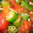 Okra with Tomatoes - Canned tomatoes and okra are simmered with green bell pepper, onion and garlic for a tasty side dish.