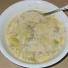 Bratwurst, Potato and Cabbage Soup - Browned and crumbled sausage is simmered with vegetables in this thick milk-based soup which is finished with Swiss cheese.