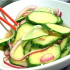 Ginger-Spiced Cucumbers - This simple cucumber salad with ginger and lime will be a refreshing side to any Asian meal.