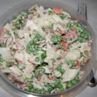 Crab and Pea Salad - A salad made with imitation crab, peas and bacon. Great for summer barbeques.